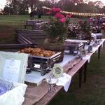 We used old shutters as a runner for the farm tables. The menu for this wedding included southern fried chicken, old fashion pot roast with gray, buttermilk mash potatoes, southern style green beans, and homemade southern chive biscuits with peach sauce..